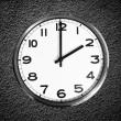Classic wall clock on black grunge wall — Stock Photo