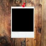 Pined polaroid on wooden wall — Stock Photo