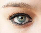 Beautiful blue woman eye close up — Stock Photo