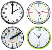 Set of 4 clocks isolated on white — Stock Photo