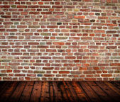 Empty room interior with brickwall and wooden floor — Stock Photo