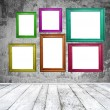 Stock Photo: Empty room with multicolored photo frames