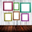 Empty room interior with colorful picture frames — Stock Photo