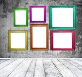 Empty room with multicolored photo frames — Stock Photo