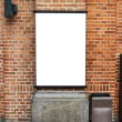 Blank billboard on brick wall — Stock Photo