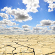 Drought landscape against bright blue sky with clouds  — Stock Photo