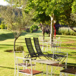 Garden patio with table and chairs — Stock Photo
