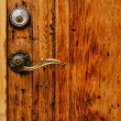 Stock Photo: Old wooden door with hande and lock close up