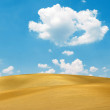 Sand dunes and bright blue sky — Stock Photo