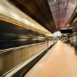 Train station and train in motion blur — Стоковая фотография
