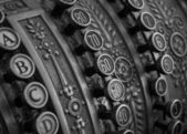 Antique cash register macro shot in bw — Stock Photo