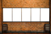 Five empty billboards on brick wall — Stock Photo