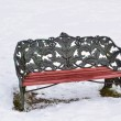 Winter bench covered with snow at the park — Stock Photo