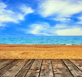 Sandy beach and seascape with wooden floor — Stock Photo