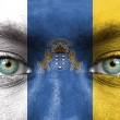 Human face painted with flag of Canary Islands — Stock Photo