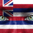 Human face painted with flag of Hawaii — Stock Photo