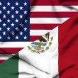 United States of America and Mexico waving flag - Stock Photo