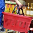 Hand holding empty shopping basket - Shopping concept — Stock Photo #24536535