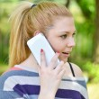 Portrait of amazed teen gilr talking on phone — Stock Photo