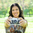 Portrait of beautiful woman taking picture mwith vintage camera — Stock Photo