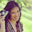 Retro image of beautiful woman holding vintage camera — Stock Photo
