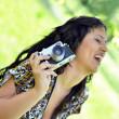 Stock Photo: Smiling womholding vintage camera