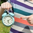 Woman hands pointing on old clock outdoors — Foto de Stock