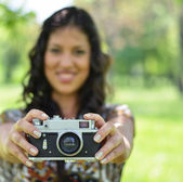 Portrait of woman holding vintage camera - Focus on camera (retr — Foto Stock