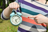 Woman hands pointing on old clock outdoors — Stock Photo