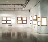 Gallery interior with empty frames — Stock Photo