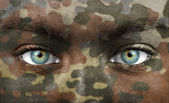 Soldier face with camo colours — Stock Photo