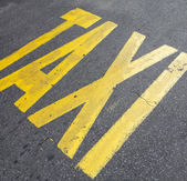 Taxi sign on street — Stock Photo