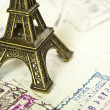 Stock Photo: Stamped passport with Eiffel passport - Travel to Paris concept