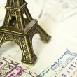 Stamped passport with Eiffel passport - Travel to Paris concept — Stock Photo #26498693