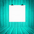 Stock Photo: Blank board hanging at wall in turquoise retro room