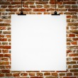 Interior of grunge empty room with empty board hanging on brick — Stock Photo