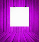 Blank board hanging at wall in purple retro room — Stock Photo