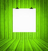 Blank board hanging at wall in green retro room — Stock Photo
