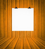 Blank board hanging at wall in orange retro room — Stock Photo