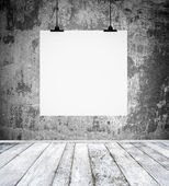 Empty room with blank paper board hanging on a wall — Stock Photo