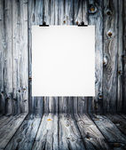Interior of wooden empty room with white paper hanging on paper — Stock Photo