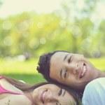 Retro image of happy young couple enjoying nature — Stock Photo