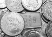 Silver coins and bars background — Stock Photo