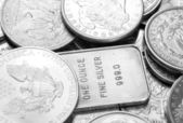 Silver coins and bars macro shot — Stock Photo