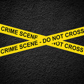 CRIME SCENE - DO NOT CROSS against black wall — Stock Photo