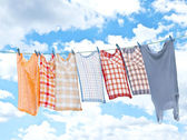 Laundry hanging over sky — Stock Photo