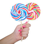 Woman hand golding two lollipops — Stock Photo