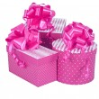 Pink gift boxes with ribbon bow isolated on white — Stock Photo