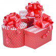 Red gift boxes with ribbon bow isolated on white — Stock Photo #32671377