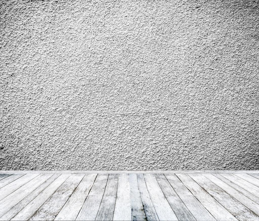 Interior de la habitaci n con paredes blancas y piso de for Paredes blancas